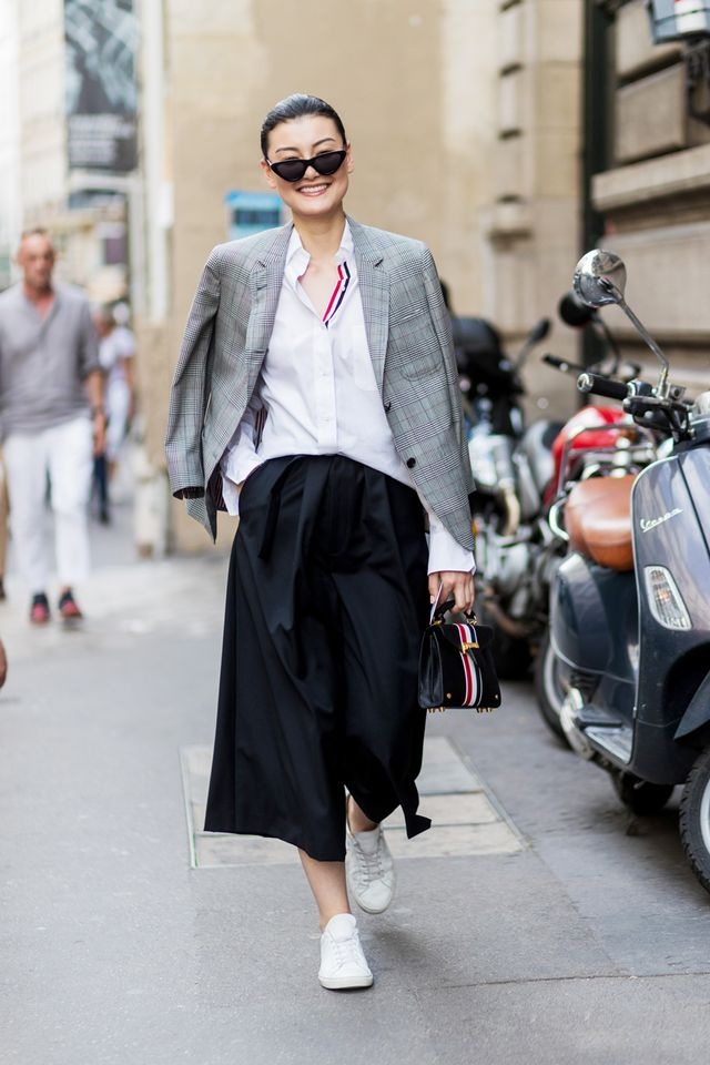 Style black culottes with a minimalist blouse and a plaid blazer. Wear the look with black pumps for an office-appropriate outfit, or take on a chic street look with your favorite white...