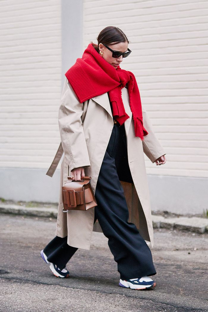 How to wear colour in winter: jumper over trench coat