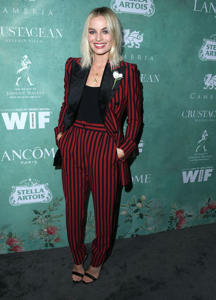 Margot Robbie Style: Wearing a black and red striped Dolce & Gabbana suit