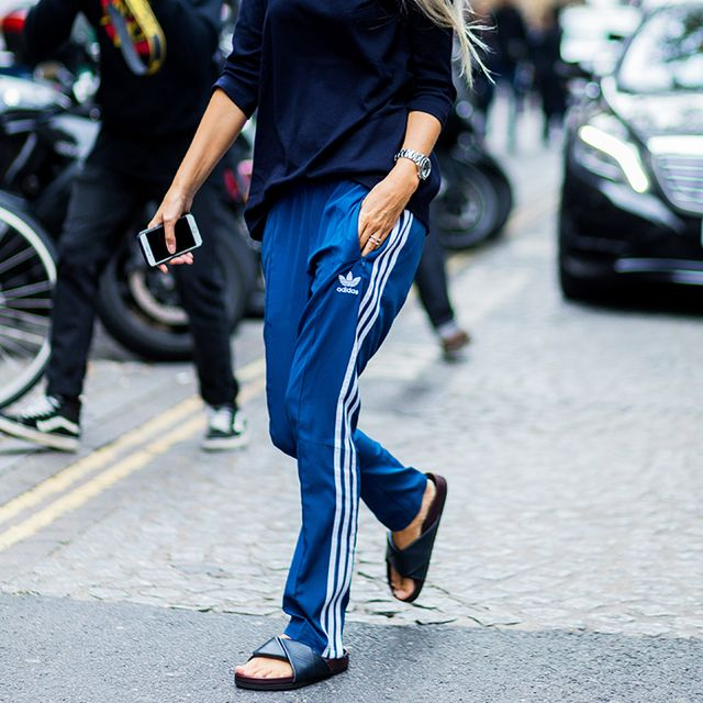streetwear: woman wearing adidas trousers