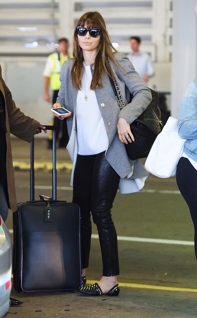 On Jessica Biel: Chanel bag; Jimmy ChooGlobe Studded Leather Flats ($795) Similar Styles: H&MCotton T-shirt ($10); Anine BingLeather Leggings ($899); Harris Wharf...