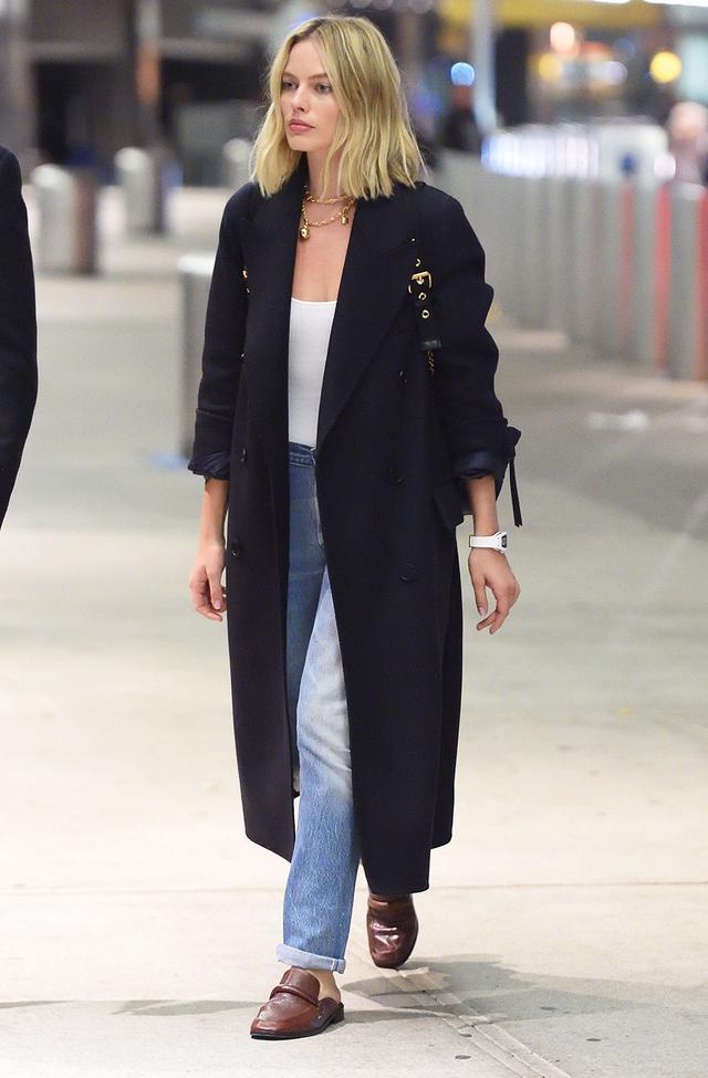 On Margot Robbie: Burberry coat and backpack; Newbark mules