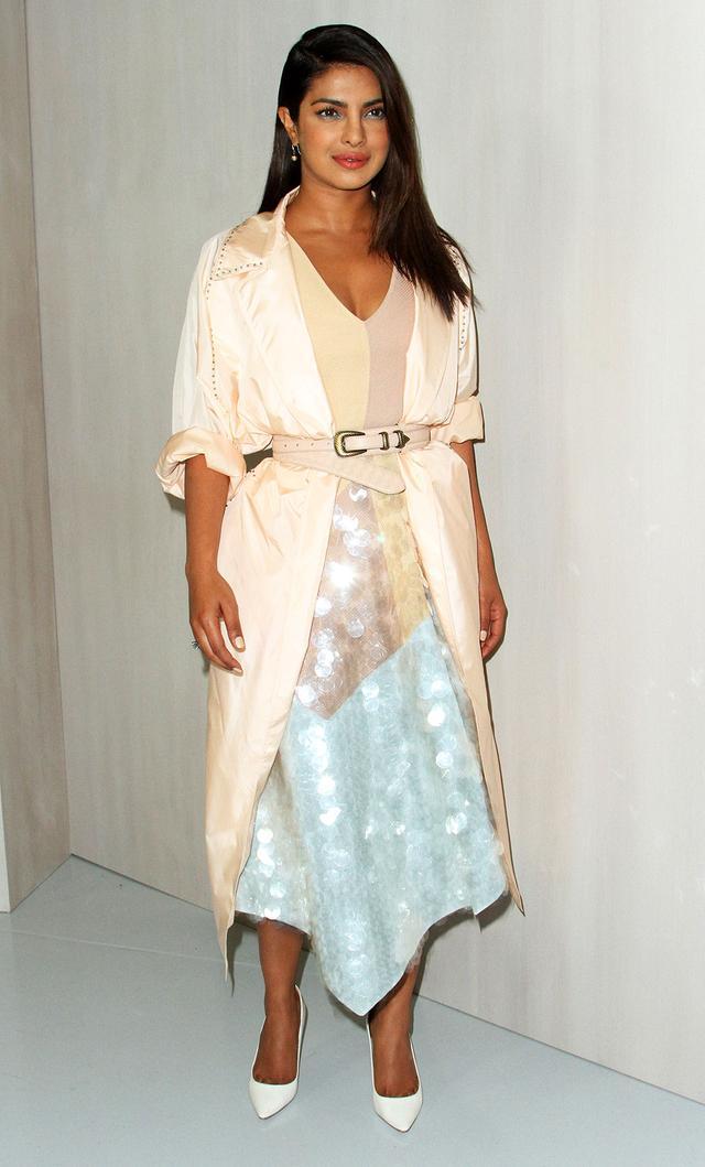 On Priyanka Chopra: Bottega Veneta dress and coat