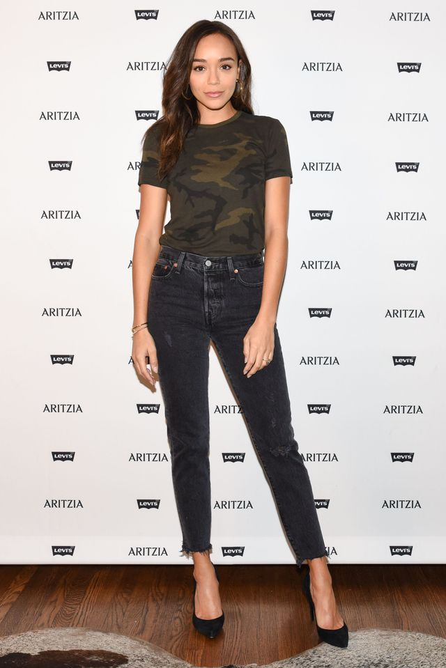 WHO: Ashley Madekwe WHAT: Ashley Madekwe, Charlotte McKinney, and more celebrities attended the Aritzia x Levi's launch party last night in Los Angeles. WEAR: TNA for Aritzia Slope T-Shirt...