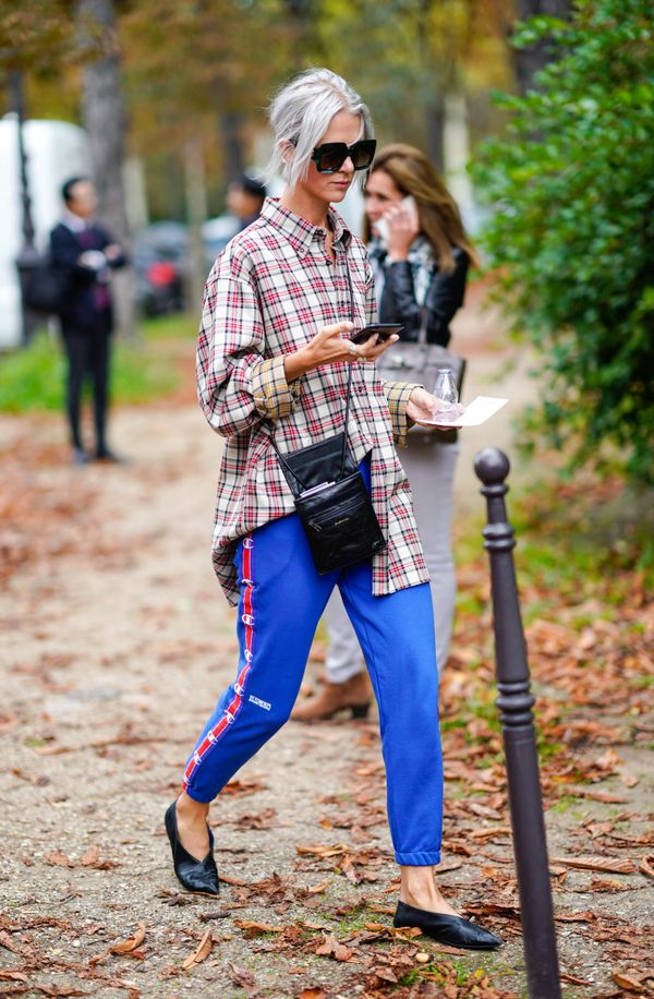 Athleisure fans need to try pairing their tartan with track pants.