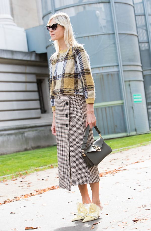 Plaids can come in any texture, including knits. And this sweater perfectly clashes with the smaller checkered design of the skirt.