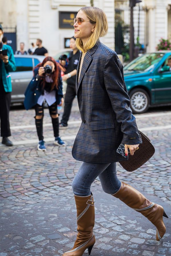 Marry a longer blazer with high boots, letting your skinny jeans peek out between the two.