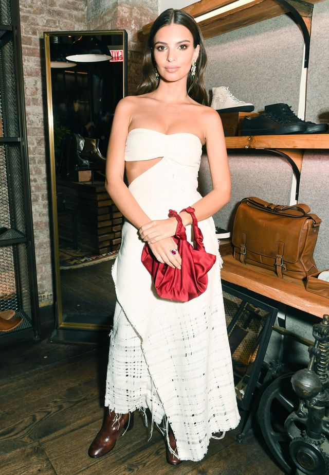 On Emily Ratajkowski:Pringle of Scotland dress; FryeJulia Harness Tall Boots($498); The Row bag