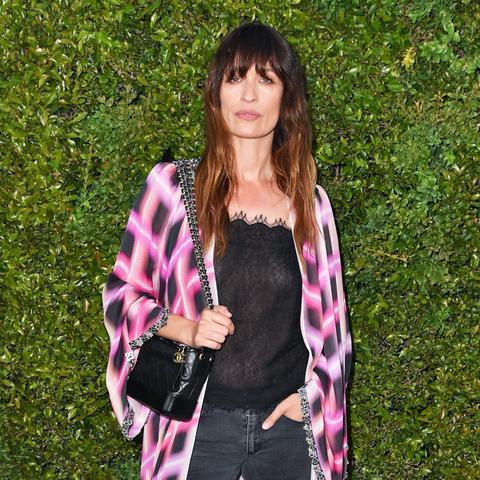 parisian style:Caroline de Maigre wearing sheer cami top, jeans and robe