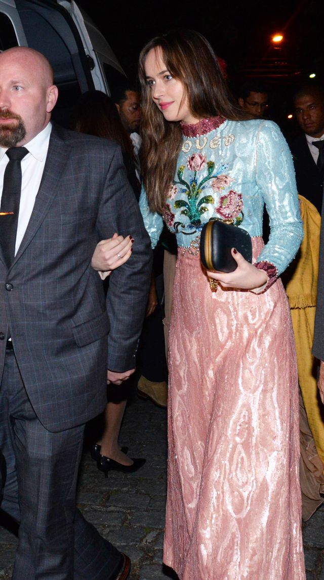 On Dakota Johnson: GucciEmbroidered Sequin Tulle Gown ($15,000)