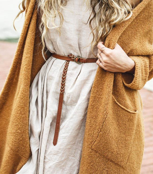 """Mitchell loves the texture and pop of warm color that her sweater adds to her cozy style. Want to make the look a bit more professional? """"Add a skinny leather belt at the waist to give the dress..."""