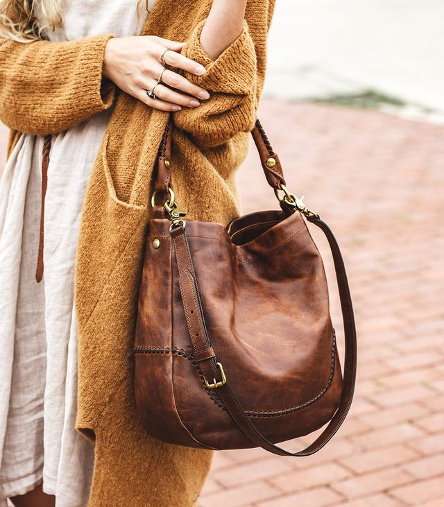 For busy workdays that take her all over Nashville, an oversize shoulder bag is key. She loves this one from Frye because it can be held by the shorter strap or worn on the shoulder for an easy...