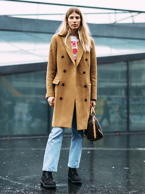 A timeless wool coat gets added cool factor with a vintage T-shirt and light-wash denim.
