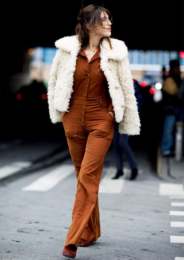 A jumpsuit works for winter months when topped off with a faux-fur jacket.