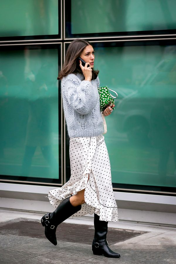 """Keep this outfit combo in mind next time you have """"nothing to wear"""": oversize sweater + satin skirt + mid-calf boots."""