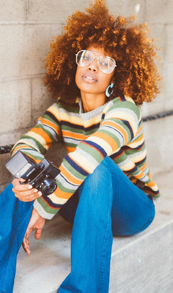 Give a striped sweater a retro treatment with flared jeans (wire-frame glasses optional).