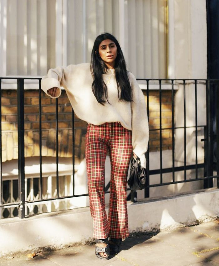 What to wear in November: Monikh Dale wearing cream knit and tartan trousers