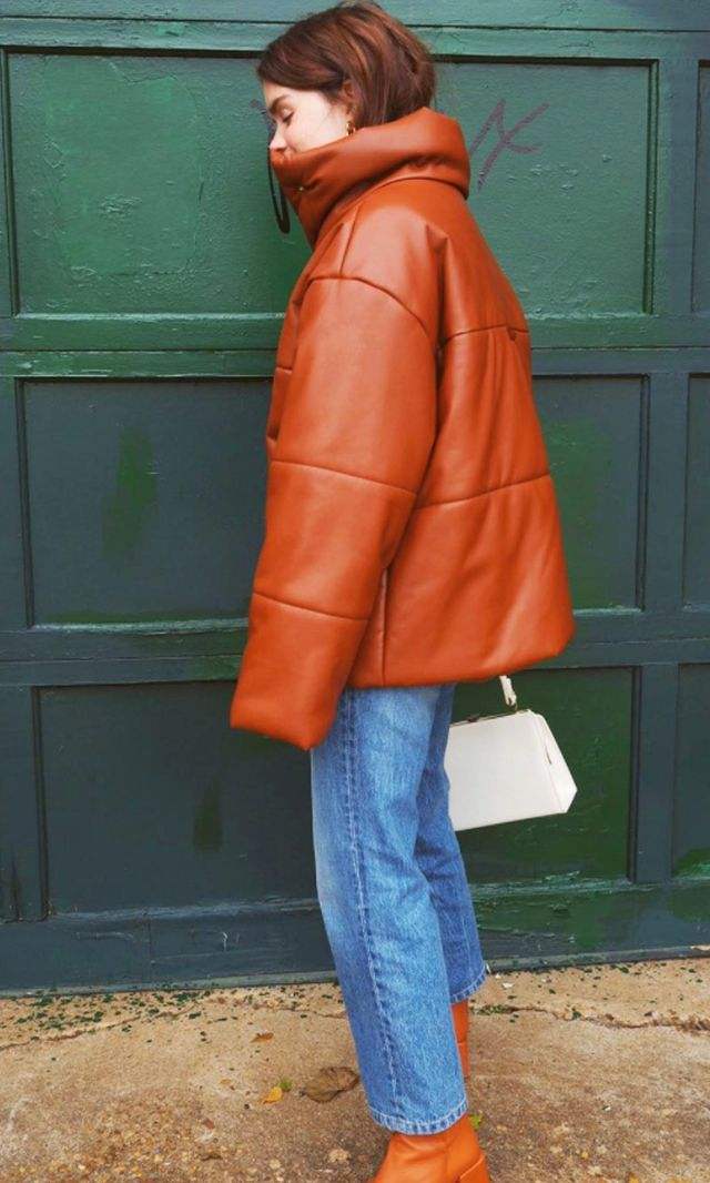 Style Notes: Reese Blutstein of Double3xposure wears her Nanushka bomber with straight-leg blue jeans and matching brown leather boots.