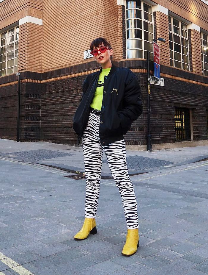 How to wear ankle boots with skinny jeans: Megan Ellaby in a pair of printed jeans and bright yellow boots
