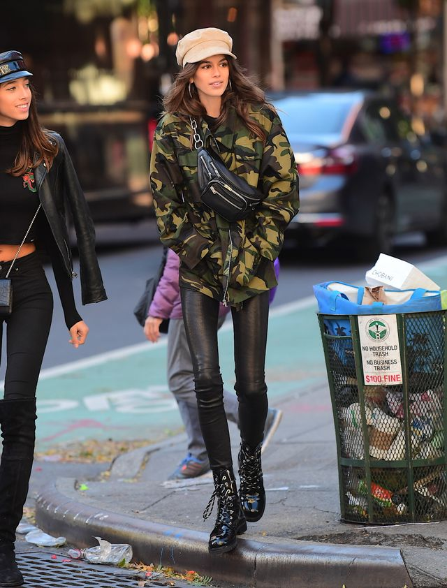 On Kaia Gerber: I.Am.Gia. Tarantino Jacket ($99); L'Agence Adelaide Leggings; Stuart Weitzman Metermaid Boots ($585); Lack of Color Dunes Hat ($70); Alexander Wang fanny...