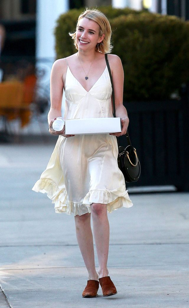 On Emma Roberts: Topshop Satin Slip Dress ($130); Chloé Pixie Round Bag ($1490)