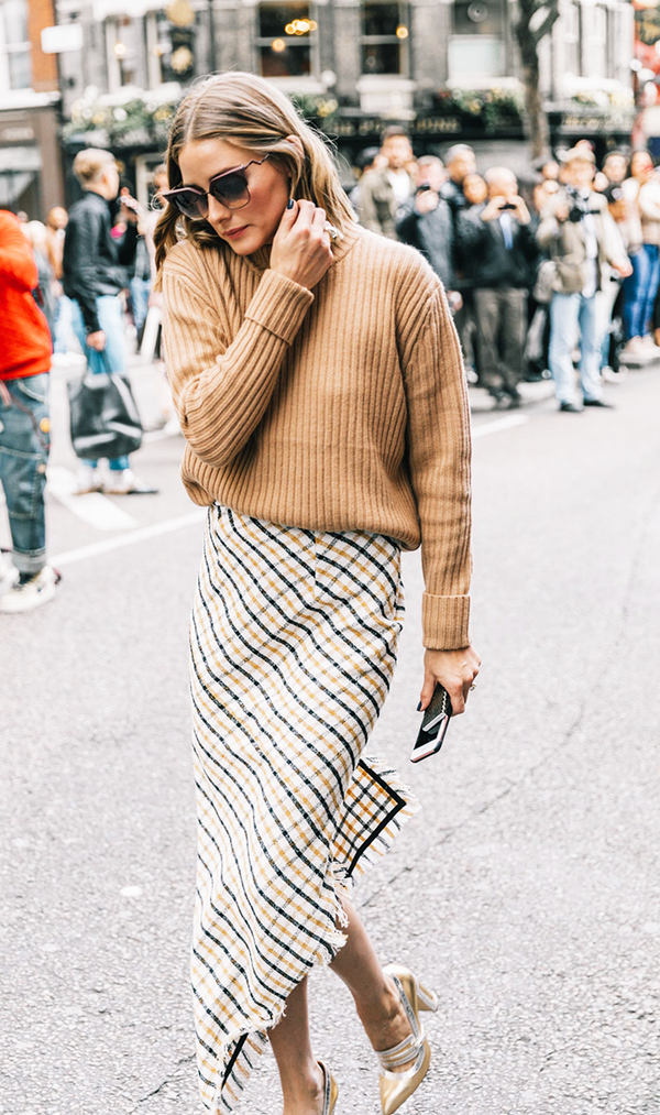 Tuck a cozy sweater into a patterned skirt and you've got yourself the ideal fall workday outfit.