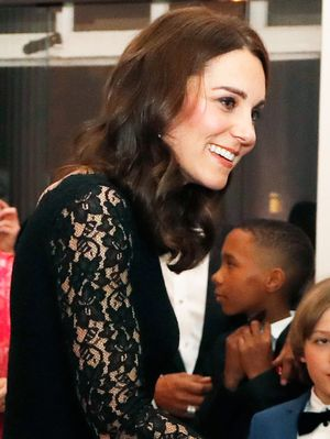Kate Middleton Shows Off Her Baby Bump in a Stunning Formfitting Gown