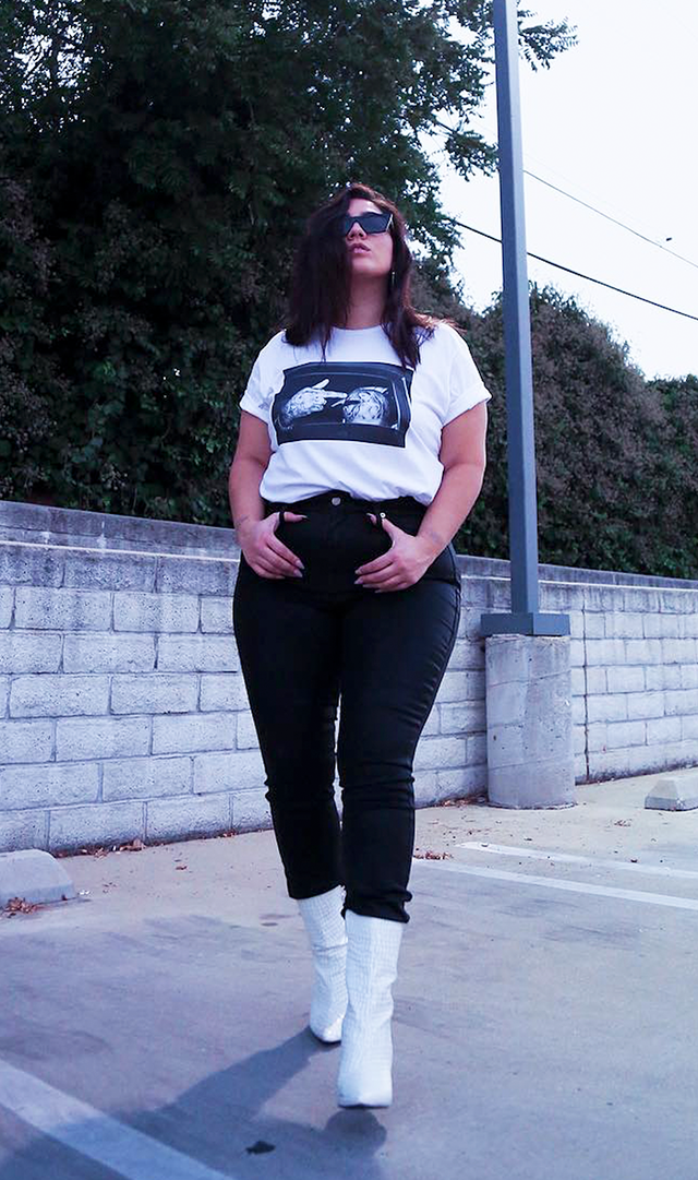 Graphic Tee + Black Skinny Jeans + White Boots