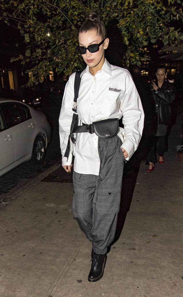 Bella Hadid wearing plaid pants street style