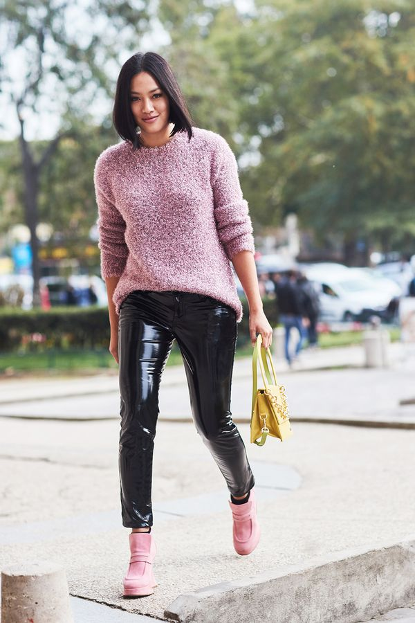 Contrast edgy patent pants with a soft pink sweater for a look anyone will love.