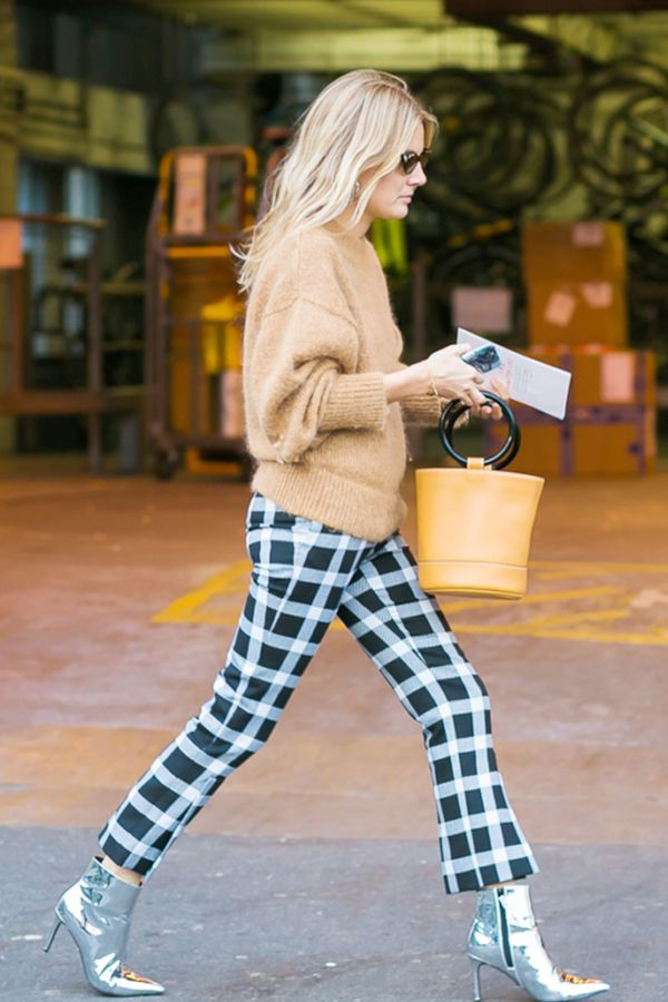 Try switching up your usual all-black look for printed pants and an elevated camel-colored sweater.