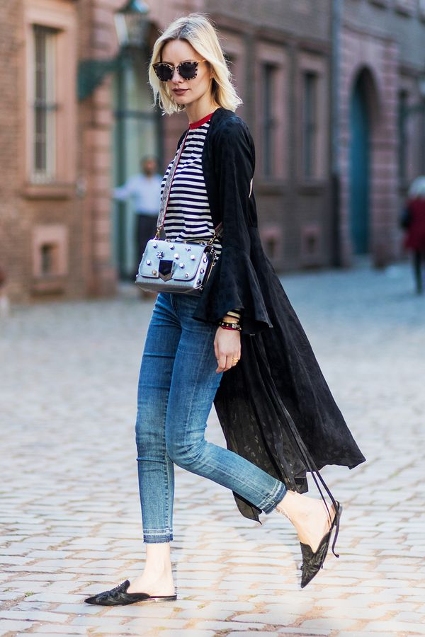 Master casual-chic by pairing a robe coat with a striped tee, jeans and statement slides.