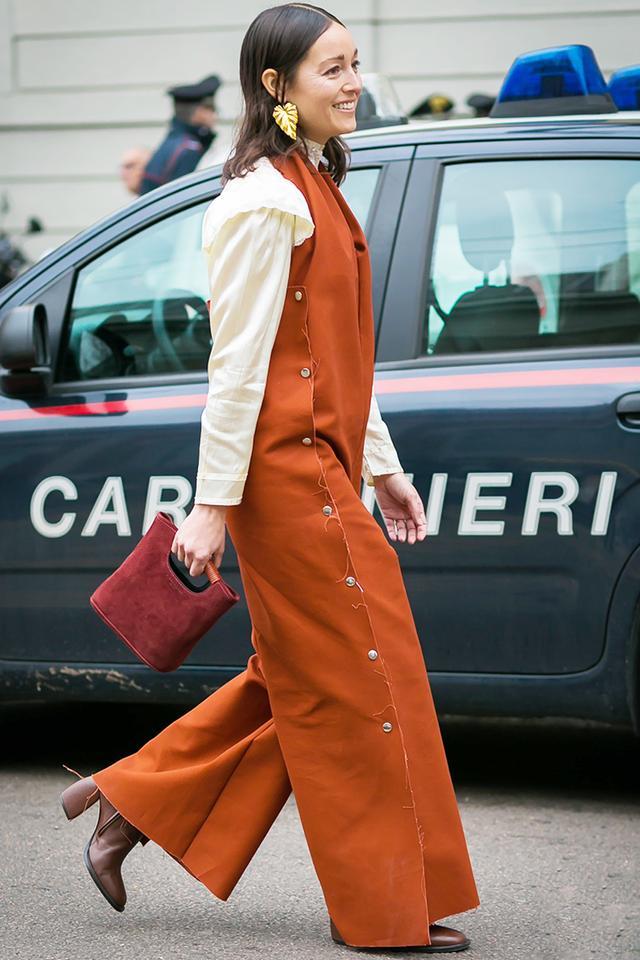 Rachael Wang in orange jumpsuit