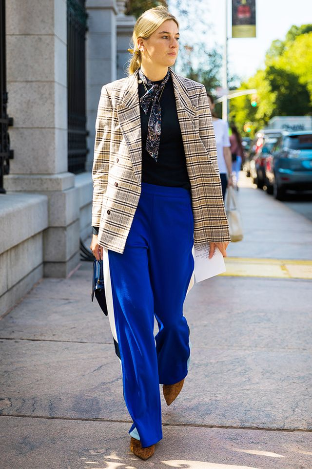 Camille Charriere in blue track pants