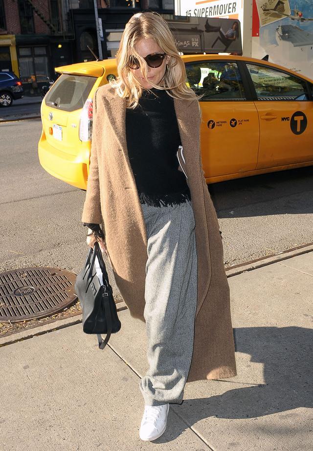 On Sienna Miller: Saint Laurent bag; Zoe Jordan Laplace Knit ($353)