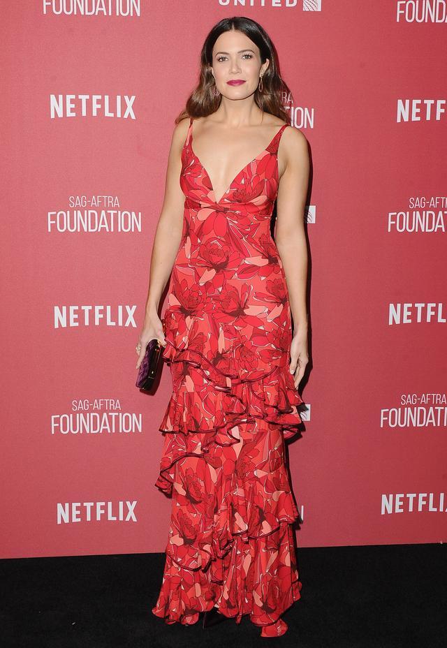 On Mandy Moore: Johanna Ortiz Crimson Floral-Print Maxi Dress ($2950)