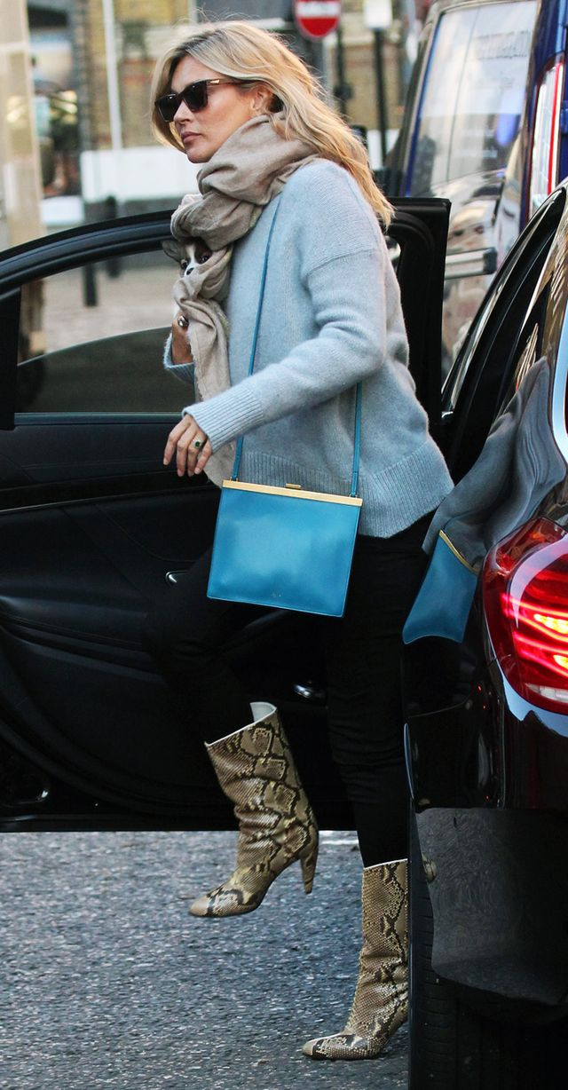 Kate Moss wearing blue jumper and snakeskin boots