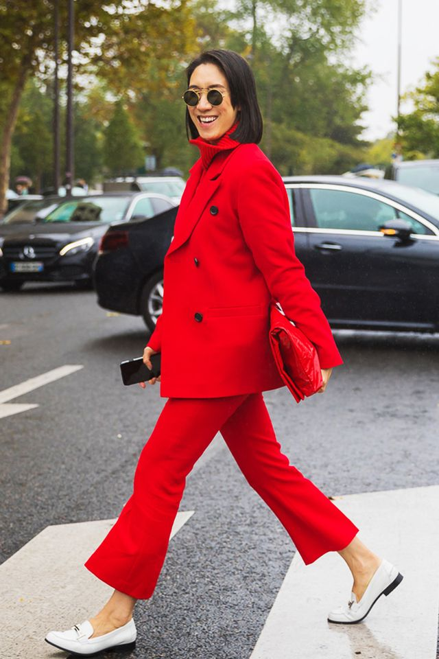 Saturate those classic wardrobe staples in red: a peacoat, turtleneck, and cropped trousers look forward with white shoes.
