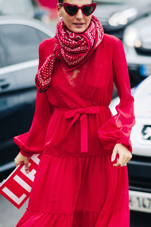 Make a red dress feel extra special by tying a printed silk scarf around your neck.