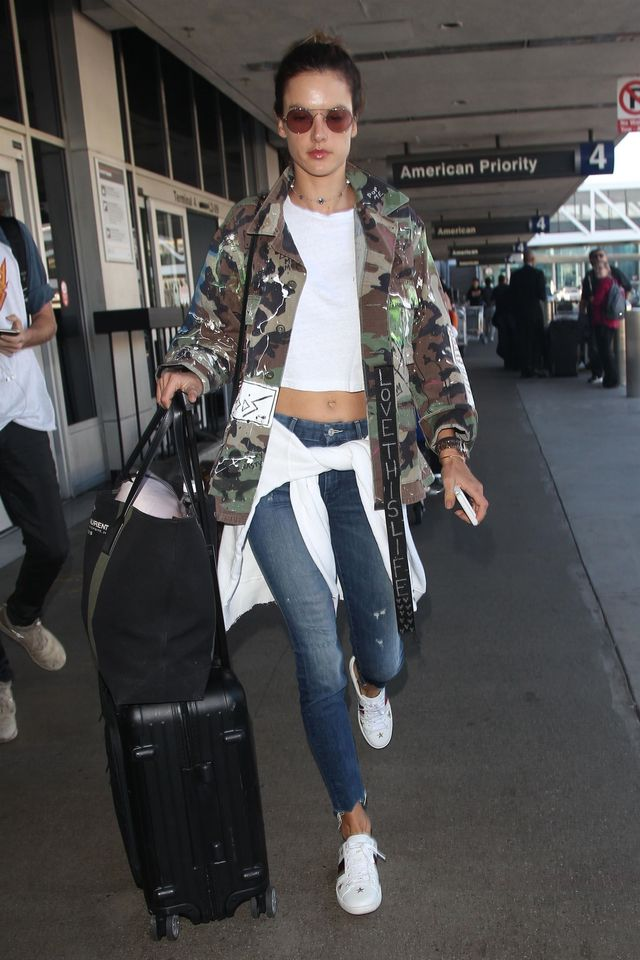 On Alessandra Ambrosio: Linda Farrow 427 C3 Rose Goldtone Oval Sunglasses ($1105); Mother Looker Ankle Fray Jeans ($258); Re/Done x Hanes 1950s Boxy Tee ($73); Louis Vuitton Neone Monogram Canvas...