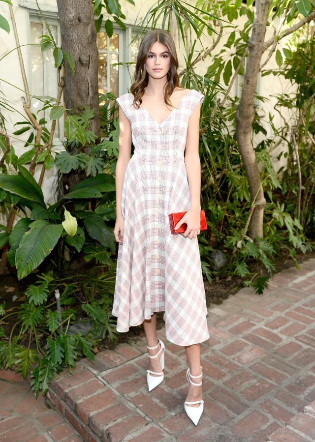 On Kaia Gerber:Veronica Beard S/S 18 dress;Edie ParkerJean Solid Acrylic Clutch Bag ($895)