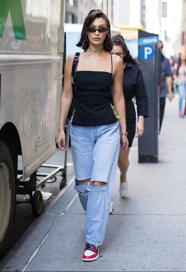 On Bella Hadid: Cult Gaia tunic; Danielle Guizio vintage Levi's jeans; Nike Air Jordan 1 Retro High OG Chicago ($525); Poppy Lissiman Le Skinny Sunglasses ($98)