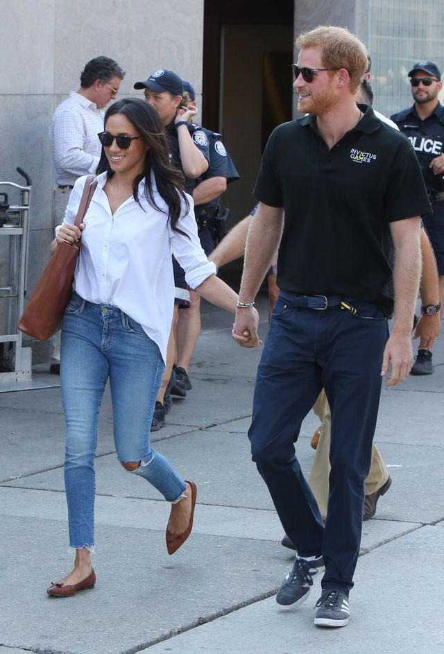 On Meghan Markle: Misha Nonoo The Husband Shirt ($185); Mother jeans; Everlane Day Tote ($165); Sarah Flint flats