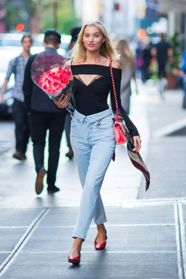 On Elsa Hosk: Jean Atelier Lace-Trimmed Compact Knit Bodysuit ($1025) and Flip Top Boyfriend Jean ($525)