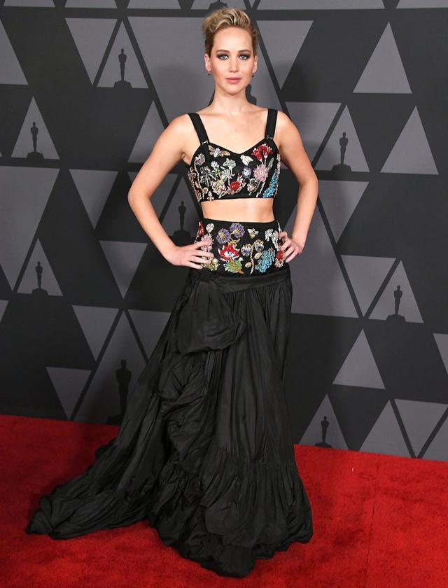On Jennifer Lawrence:Alexander McQueen Resort 18 dress