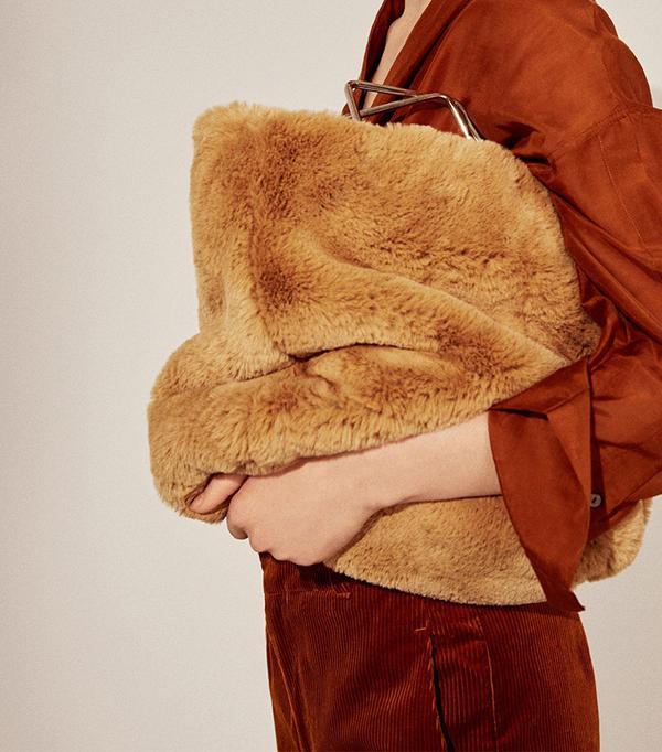 Metallic handle faux-fur bag