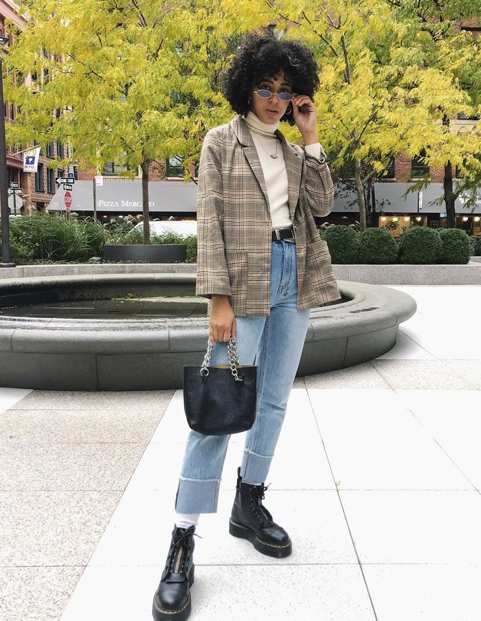 How to shop Monki: Chiara Cherise wearing a checked Monki blazer