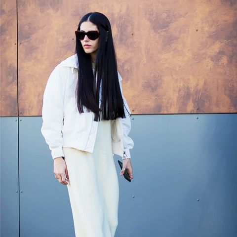 ways to wear maxi dresses in winter: all white with a bomber jacket and white maxi dress