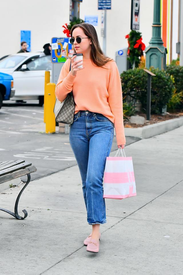 Dakota Johnson wearing Gucci loafers.