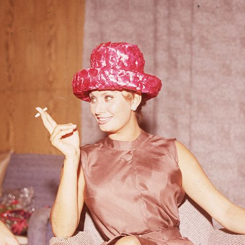 sophia loren style: in a brown dress and red hat